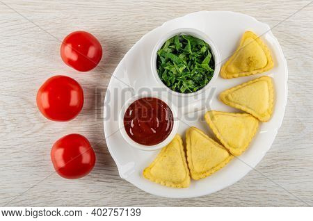 Red Tomatoes On Wooden Table, Sauce Boat With Ketchup, Chopped Parsley In Bowl, Small Savory Pies In