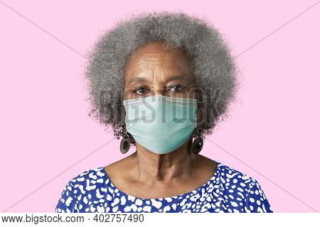 Elderly woman wearing mask for Covid-19 prevention campaign