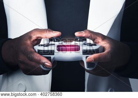 Hands holding video game controller