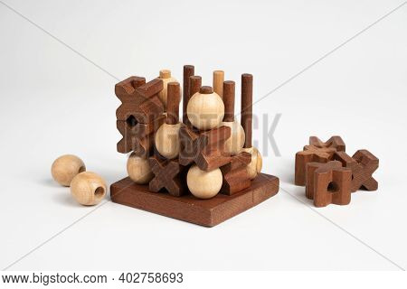 The Finished Game Of Tic-tac-toe. Three-dimensional Wooden Voluminous Field For Tic-tac-toe Competit