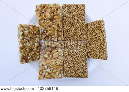 Tilgul Or Sesame Seeds Sweet Candy Bar And Peanut Groundnut Chikki Served Prepared During Festival O