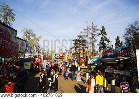 Prague , Czech Republic-march 30, 2019: Different Swings, Carousels Flying High In The Air, Shops, E