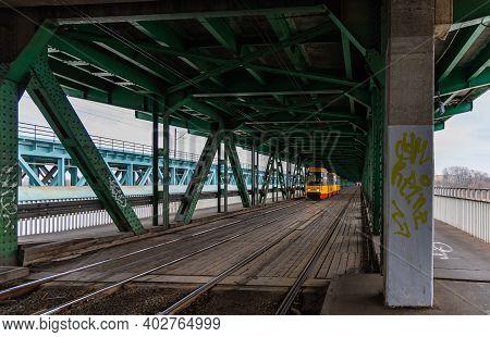 Warsaw January 20 2020 Yellow Tram Drive To Tram Station By Gdanski Bridge