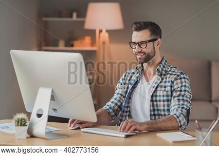 Photo Of Young Cheerful Handsome Man Happy Positive Smile Remote Work Computer Programmer Desk Indoo