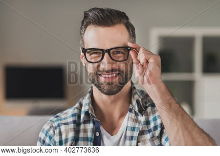 Photo Of Young Handsome Cheerful Man Happy Positive Toothy Smile Confident Hand Touch Eyeglasses Hom
