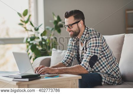 Profile Side Photo Of Young Handsome Man Happy Positive Smile Sit Sofa Home Distance Work Videocall