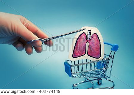 The Doctors Hands Lower Painted Lungs Into The Shopping Cart. Symbol Of Organ Transplantation. Illic