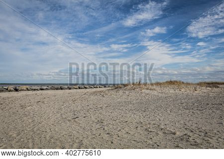 Beach And Sand Dunes At Barnegat, Nj, On A Brisk Winter Day Under Blue Cloudy Sky