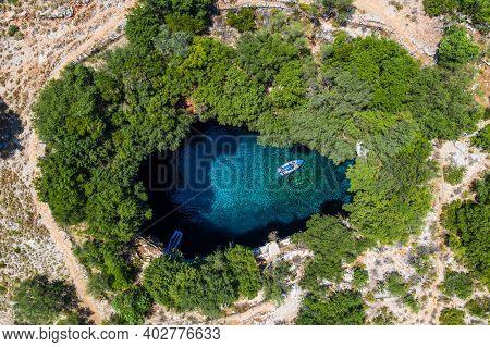 Kefalonia, Greece. Aerial View Of Melissani Cave, Sami Village.