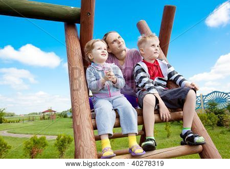 Happy family at park playground