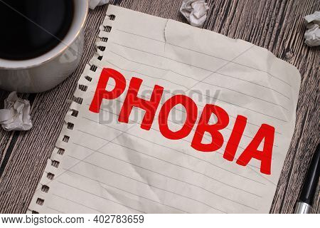 Phobia, Text Words Typography Written On Paper Against Wooden Background, Life, Psychology And Menta