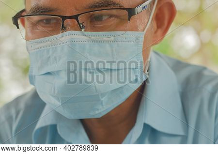 Covid-19 And Air Pollution Pm2.5 Concept. Old Man Wearing Mask For Protect Pm2.5 And Corona Virus Ou