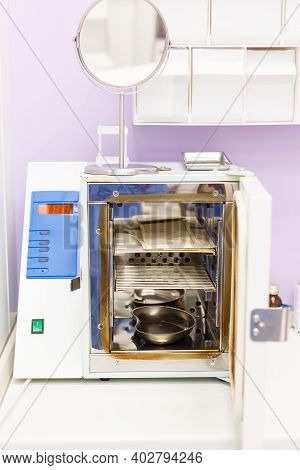 Steam Sterilizer Autoclave With The Door Open In A Medical Laboratory Or Clinic.