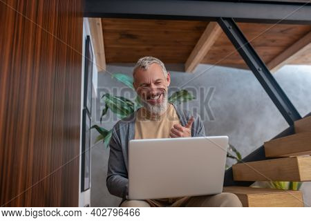 Grey-haired Mature Confident Man Working At Home