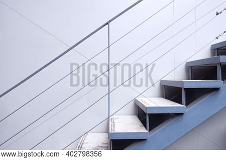 Side View Of Cement Stairs With Metal Handrails
