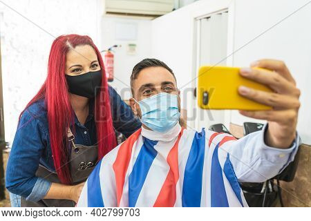 Barber Woman And Costumer Taking Selfie At The Barber Shop. Young Woman Working As A Hairdresser. Sm