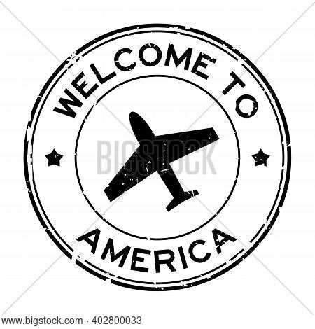 Grunge Black Welcome To America Word With Airplane Icon Round Rubber Seal Stamp On White Background