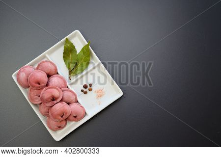 Pink Frozen Homemade Dumplings And Spices In A Square Plate On A Gray Background. Homemade Semi-fini