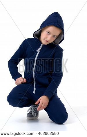 Portrait Of Boy In Blue Hoodie With Serious Face. Stylish Preteen Boy Looking At Camera Posing In Fr