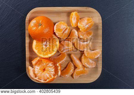 Citrus Mandarins Top View. Peeled Mandarins In A Bamboo Bowl. Mandarin Juicy Ripe Fruit.