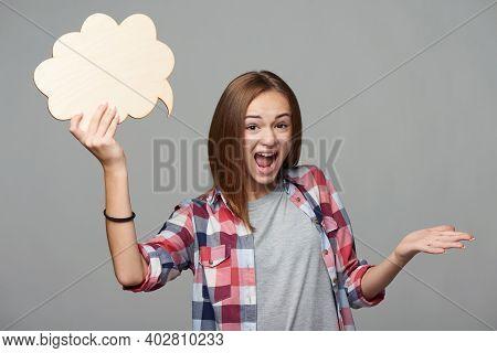 Indignant Female Holding Thinking Bubble And Screaming