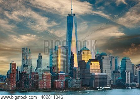 New York City Manhattan skyline at sunset over Hudson River viewed from New Jersey