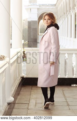 Business Woman In Pink Coat And Bag Sitting On City Park Architecture White Background