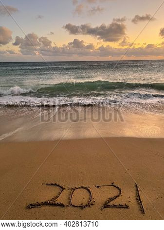 2021 hand drawn on sand beach, Sea view from tropical beach with sunny sky