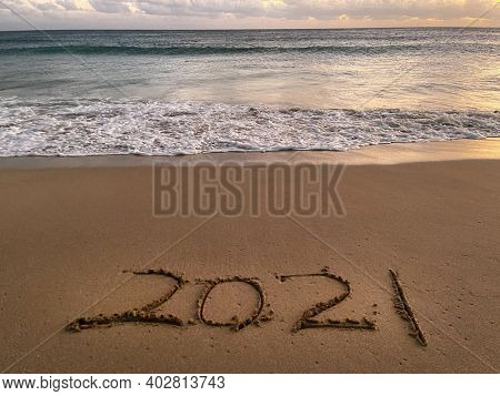 Sea view from tropical beach with2021 hand drawn on sand beach