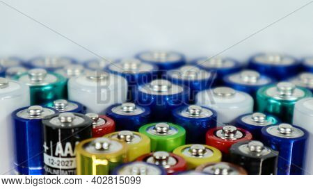 Lots Of Aa And Aaa Alkaline Batteries On A White Background. Ecological Recycling Concept. The Termi