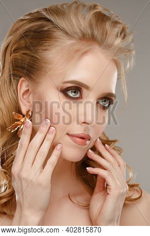 Amazing woman. Beauty model takes care of skin face. Beautiful girl with perfect fresh skin, healthy hair, beautiful manicure. Beautiful lady. Beautiful updo hairstyle with shiny curly hair. Waves