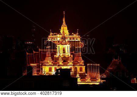 Spectacular Night View Of Top Of Loha Prasat Of Wat Ratchanatdaram Temple And Phu Khao Thong (golden