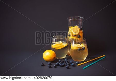 Pitcher And Glasses Of Summer Lemonade With Blueberries And Lemon, Blueberries, Lemon And Drinking S
