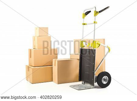 Heap Or Stack Of Brown Carton Transport Boxes With Barrow Over White Background, Delivery, Freight O