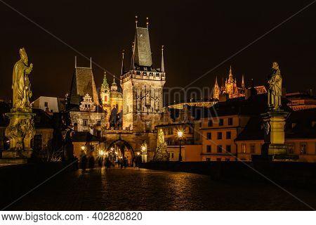 Night View Of The Illuminated St Nicolas Church,charles Bridge And Prague Castle,czech Republic.nigh