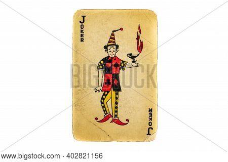 Old Damaged Joker Card On White Background