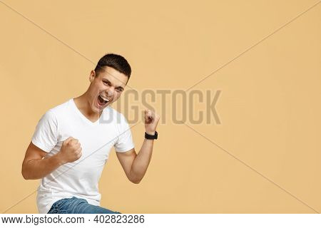 Victory, Dance Of Success, Expression Of Win And Great Offer. Joyful Young Male Student In White T-s