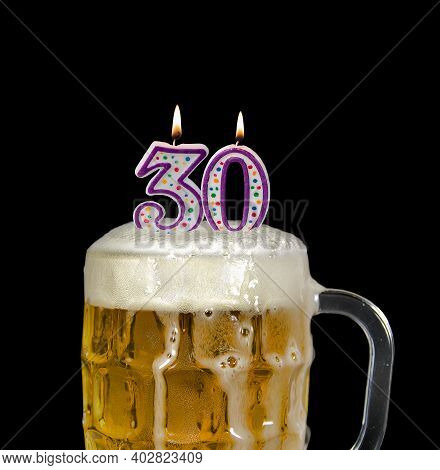 Number 30 Candles In Beer Mug For Birthday Celebration Isolated On Black
