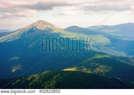 Hoverla Peak Of Carpathian Black Ridge. Beautiful Summer Landscape At Noon. Clouds On The Sky Above