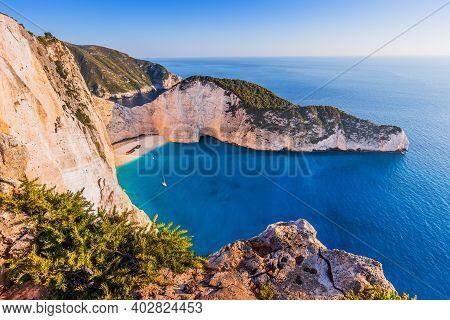 Zakynthos, Greece. Navagio Beach With Shipwreck At Sunset.