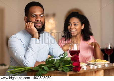 Bad Date. African American Couple Having Unsuccessful Blind Date In Restaurant, Funny Disappointed S