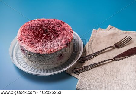 Diet Low-calorie Raspberry Sponge Cake With Jelly, Whipped Cream And Fresh Berries And Tableware On