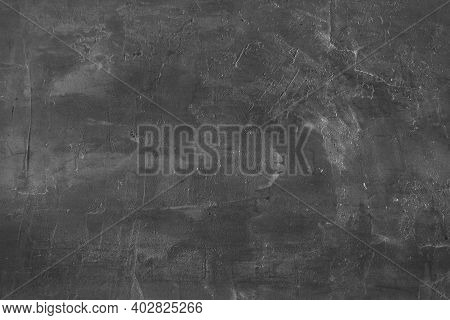 Black Concrete Wall Background. Grungy Dark Gray Painted Cement Texture. Wet Chalk Board Material Cl