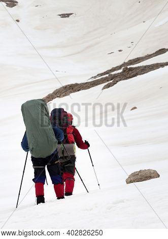 Two Hikers On Snowy Plateau At Gray Day. Turkey, Central Taurus Mountains, Aladaglar, Anti Taurus, P