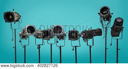 Theater Stage Equipment, Black Spotlight Projectors On A Teal Background