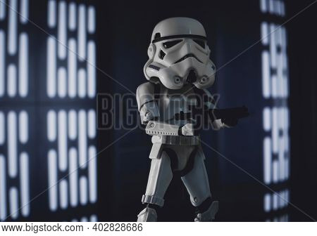 JAN 10 2021: JAN 10 2021: humorous image of a Star Wars Stormtrooper with an oversized helmet - various scale Hasbro toys