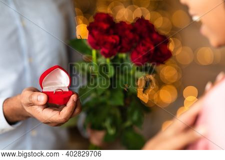 Will You Marry Me. Closeup Of Unrecognozable African American Man Showing Open Box, Offering Marriag