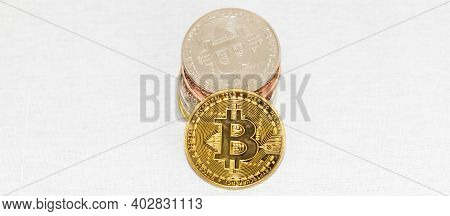 Horizontal View Of A Pile Of Bitcoin Coins And One Gold Coin Facing Forward With Copy Space.