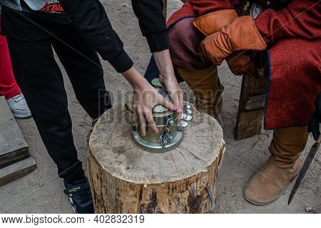 Moscow, Russia - September 5, 2020: Stamping Embossing Decorative Coins At The 17th Century Festival