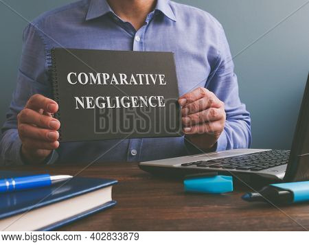 Man Shows Comparative Negligence Data In The Book.